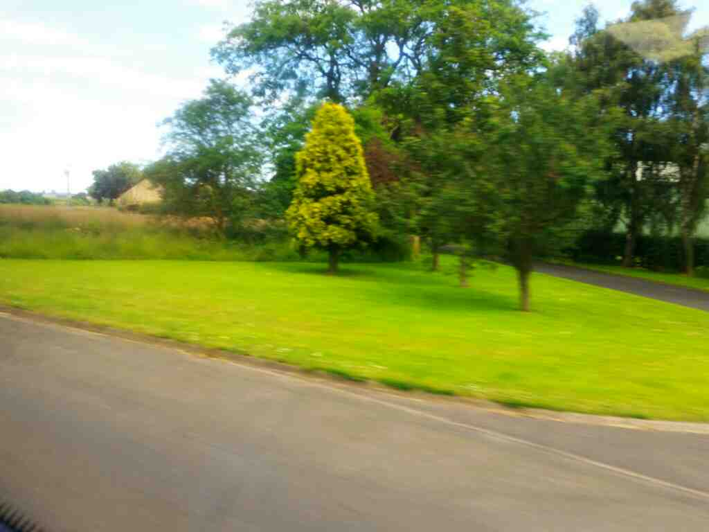 Passing an unamed Rd that leads to Thirston New Houses on a X15 Newcastle to Berwick bus