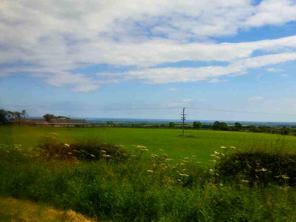 View of the sea from the road into Shilbottle on a X15 Newcastle to Berwick bus