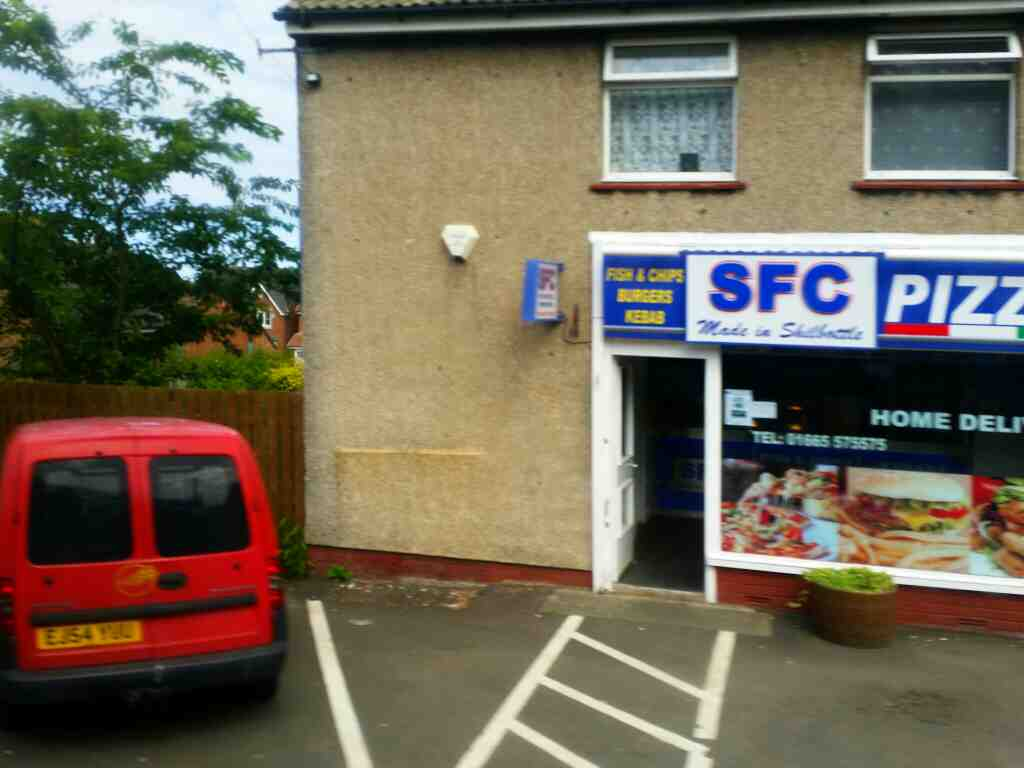 Passes SFC kebab shop Percy Road Shilbottle on a X15 Newcastle to Berwick bus
