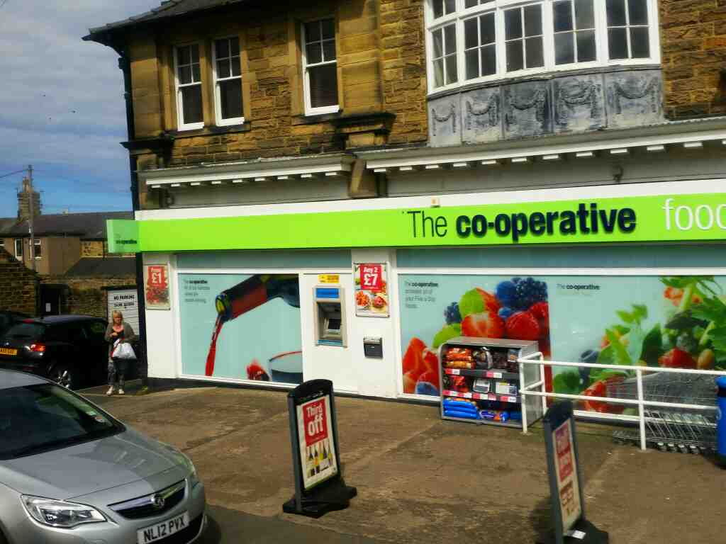 Passes the Co op Victoria Terrace Alnwick on a X15 Newcastle to Berwick bus