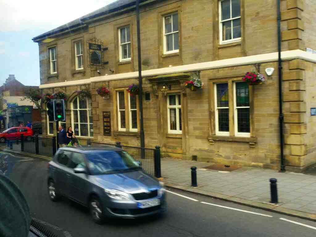 Passing the County Pub Gosforth as we travel along High St on a X15 Newcastle to Berwick bus