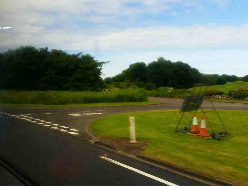 Passing the end of an unamed road on the A1 on a X15 Newcastle to Berwick bus