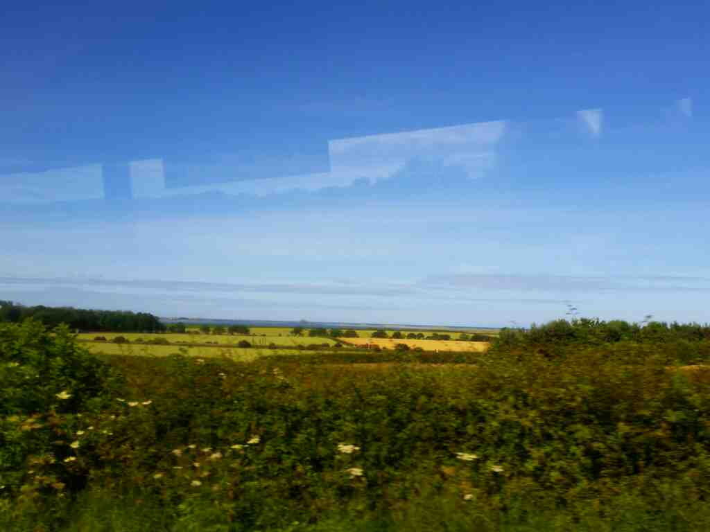 Lindisfarne Castle from an unamed road north of Belford on a X15 Newcastle to Berwick bus