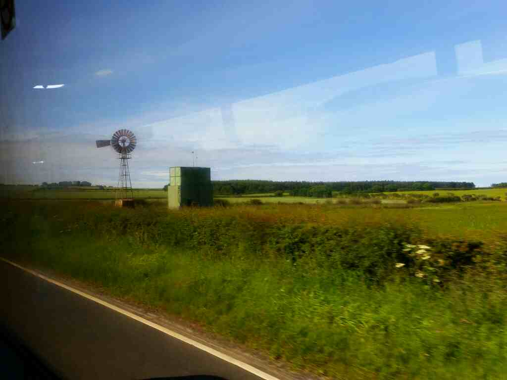 An old fashioned wind turbine south of Scremerston on the A1 on a X15 Newcastle to Berwick bus