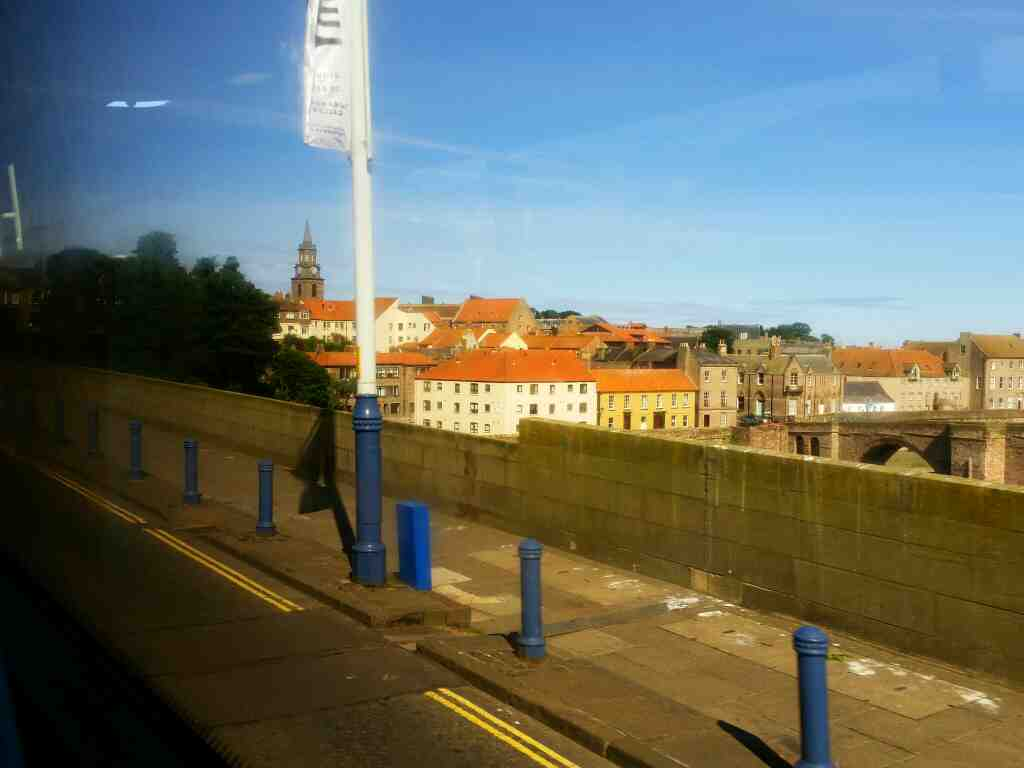 Approaching Berwick town centre on Royal Tweed Bridge we can also see Berwick Bridge on a X15 Newcastle to Berwick bus