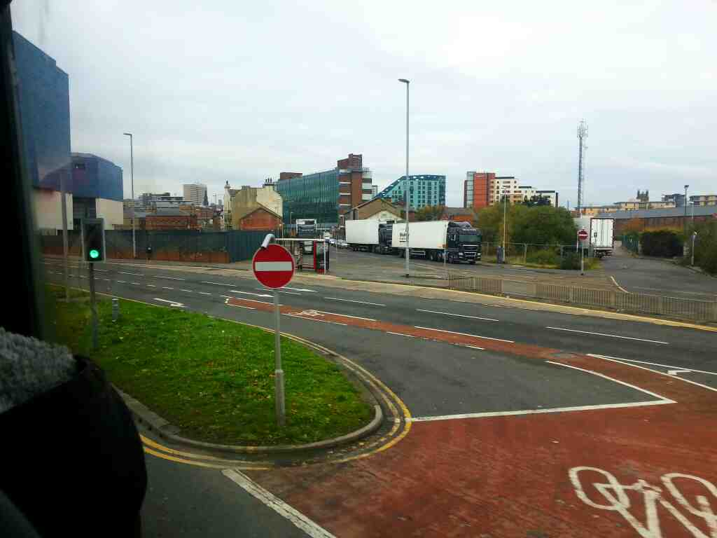 Continuing down Hunslet Lane  the A61 towards Leeds city centre on a 110 bus