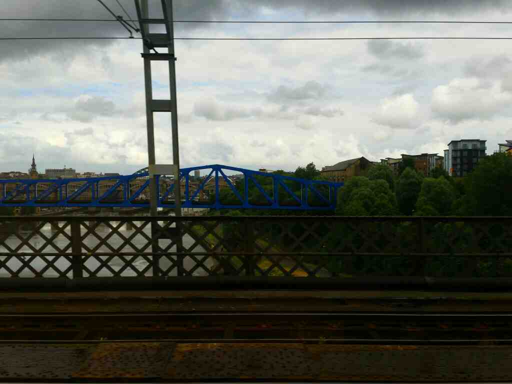 Crossing the River Tyne on the King Edward V11 bridge Newcastle