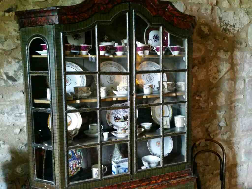 Cabinet in dining room Lindisfarne Castle Holy Island Northumberland