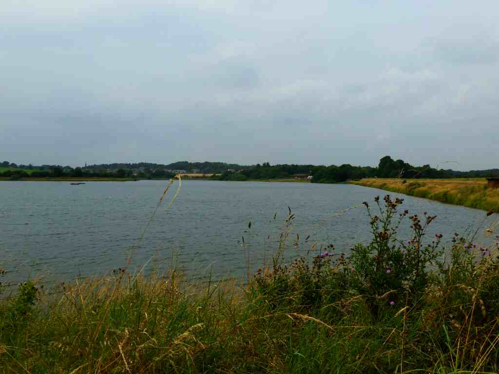 Looking back towards Lakeside cafe and visitor centre from the eastern end of the dam wall Thrybergh Country Park
