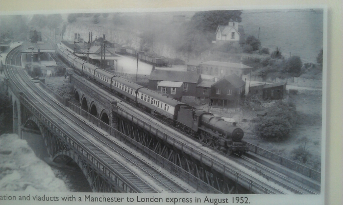 A train passes through Millers Dale station  in 1952